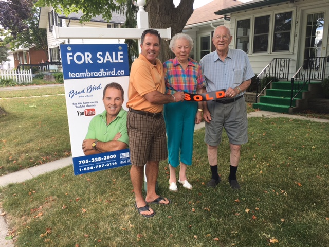 Brad with Gord and Irene Henry after sale of 3 Duke Street Lindsay