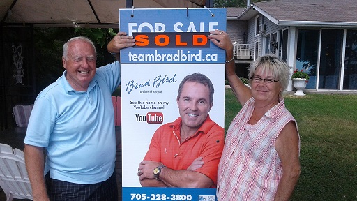 The Rodmans with their Team Brad bird SOLD sign